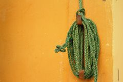 Green rope was tied to a pole. Royalty Free Stock Photo