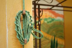 Green rope was tied to a pole. Stock Photography