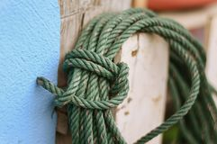 Green rope on wood pole Stock Photo
