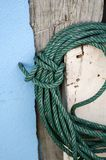 Green rope on wood pole Royalty Free Stock Images