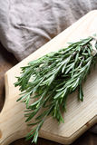 Green rosemary on the board Royalty Free Stock Photography