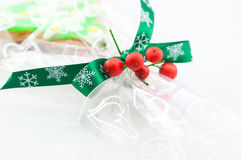 Green rosette ribbon. Beautiful green rosette ribbon with snow for the Christmas stock image