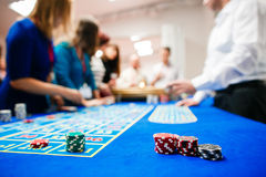 Green roulette table with colored chips ready to play.  royalty free stock photography