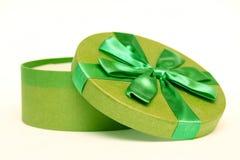 Green round box. Opened green round box with nice ribbon Stock Photo