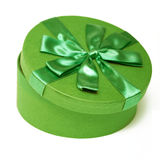 Green round box. With a green ribbon on white background Stock Image