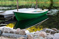 Green rowboat near dommy Royalty Free Stock Photography