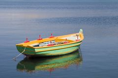 Green rowing boat in the harbour at Argostoli, Kefalonia, Septem Royalty Free Stock Images
