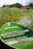 Green rowing boat in lake Stock Images
