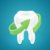 Green аrrow protected human teeth on blue background Stock Photos