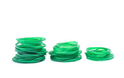 Green rubber bands against on white background Royalty Free Stock Photo