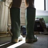 Green rubber boots. Royalty Free Stock Photo