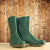 Green rubber boots for garden work Stock Photo