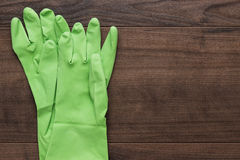 Green rubber cleaning gloves Stock Images