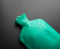 Green rubber hot water bottle Royalty Free Stock Image