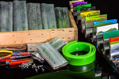A green rubber roll for screen print. Rubble print handle use for screen printing in tee shirt factory stock photo