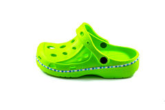 Green rubber sandal on a white background Royalty Free Stock Image