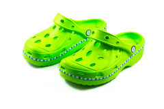Green rubber sandals on a white background Stock Photos