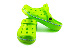 Green rubber sandals on a white background Stock Images