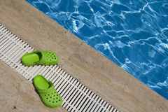Green rubber slippers Stock Images