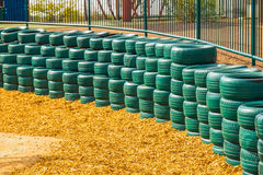 Green Rubber Tires Used As Bumpers For Small Children at Desert Royalty Free Stock Images