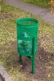Green rubbish bin in nature.  Stock Photo