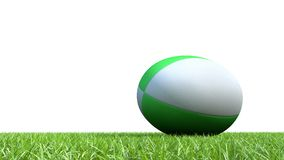 Green rugby ball on grass V03. 3D green rugby ball on grass V03 Royalty Free Stock Image