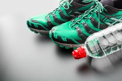 Green runners and a bottle Royalty Free Stock Photos