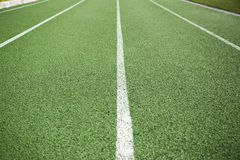Green running lanes. Green lanes on a running track Stock Images