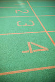 Green running track. Starting point of green running track, lanes 1 to 4 Stock Image