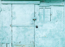 Green rural wall  with locked door and window Stock Photography