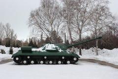 Green Russian battle tank on winter background stock photo