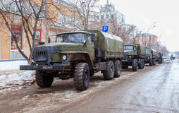 Green russian military truck URAL 4320 worth in the row on a cit Stock Images