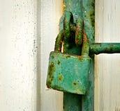 Green rusty iron padlock Stock Photo