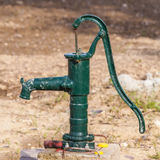 Green rusty manual water pump Stock Images