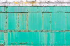 Green Rusty metal painted background, grunge texture,train surface. Royalty Free Stock Images