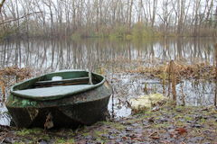 Green rusty rowing boat Royalty Free Stock Photo
