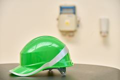 Green safety helmet on a table Stock Photo