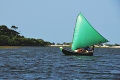 Green sail. Boat with a green sail navigating Stock Photography