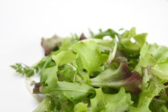 Mixed salad. On white background Royalty Free Stock Photo