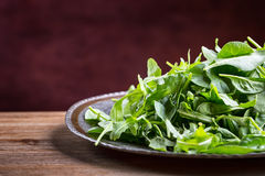 Green salad arugula and baby spinach with lime Stock Images