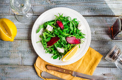 Green salad with arugula beet and goat cheese, lemon, organic fo Royalty Free Stock Photography