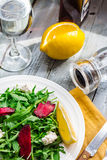 Green salad with arugula beet and goat cheese, lemon, organic fo Stock Images