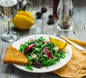 Green salad with arugula, beets, goat cheese and prunes, ruddy t Stock Photos