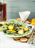 Green salad with arugula, yellow tomatoes,grapes, sesame, select. Fresh green salad with arugula, yellow tomatoes, olives, grapes and sesame,healthy lifestyle Stock Photography