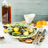 Green salad with arugula, yellow tomatoes,grapes, sesame, select. Fresh green salad with arugula, yellow tomatoes, olives, grapes and sesame,healthy lifestyle Royalty Free Stock Photos