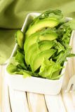 Green salad with avocado and arugula Stock Photos