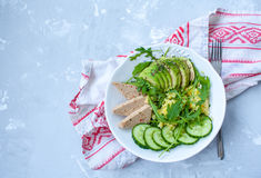Green salad with avocado, couscous and tofu. Royalty Free Stock Photography