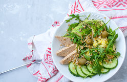 Green salad with avocado, couscous and tofu. Royalty Free Stock Photos
