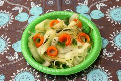 Green salad with carrots stock image