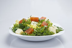 Green salad with cheese and quince Stock Photography